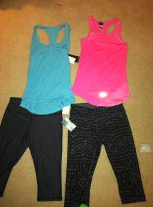 Blue tank and both pairs of capris are Zelle, Pink tank is Nike