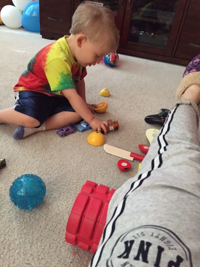 Foam rolling while little man plays